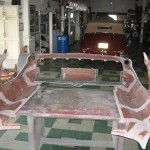 Front clip bonding seams sanded for adhesive on 1963 Corvette Roadster project