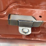 Rear traction bar forward attach point